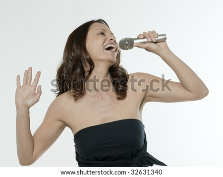 portrait of a beautiful asian woman on isolated white background singing - stock photo
