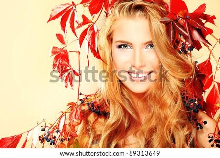 Portrait of a beautiful autumn woman. - stock photo