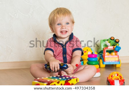 Portrait beautiful baby boy on floor stock photo 497334358 portrait of a beautiful baby boy on the floor with car toys 15 negle Images