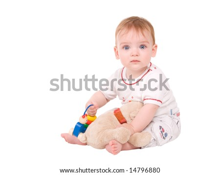 portrait of a beautiful baby girl with toys