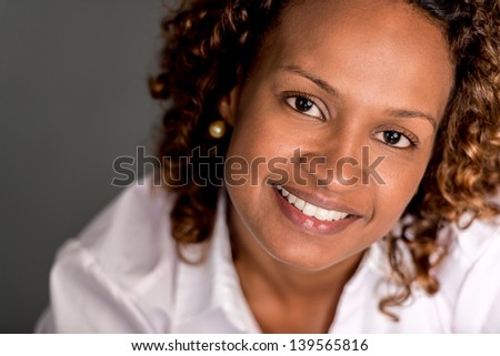 Portrait of a beautiful black woman looking happy - stock photo