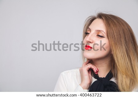 portrait of a beautiful blond white background emotions