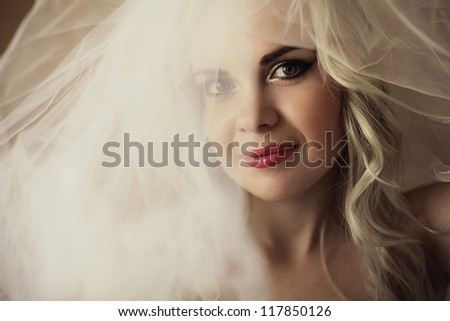 portrait of a beautiful blonde bride. daylight. studio shot