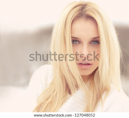 portrait of a beautiful blonde in warm colors - stock photo