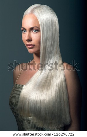 Portrait of a beautiful blonde with a long futuristic hair