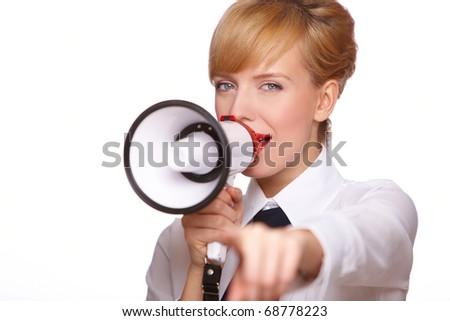 Portrait of a beautiful blonde woman shouting through megaphone - stock photo