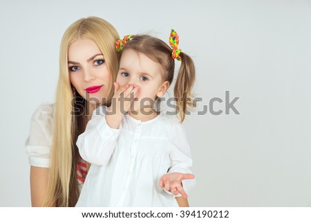 Portrait of a beautiful blonde woman with her daughter - stock photo