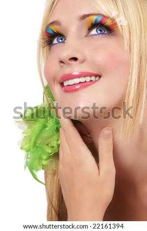 Portrait of a beautiful blonde woman with light blue eyes and colorful make-up isolated on white background - stock photo