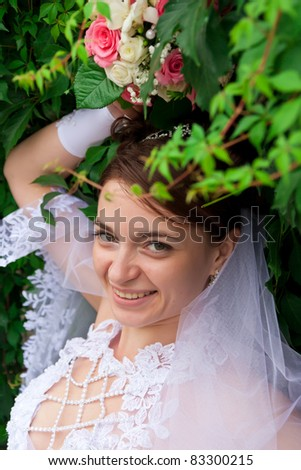 Portrait of a beautiful bride at green wall