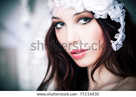 portrait of a beautiful bride, indoor shot, selective focus - stock photo