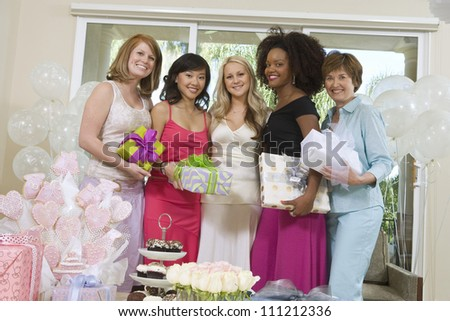 Portrait of a beautiful bride with her friends and mother at party - stock photo