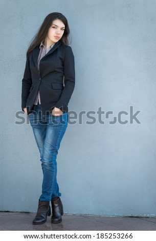 Portrait of a beautiful brunette girl in coat.