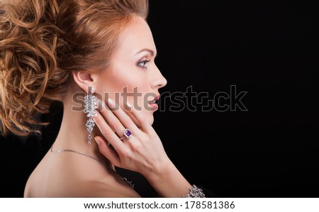 portrait of a beautiful brunette girl with luxury accessories.Beauty with jewelery. on black - stock photo
