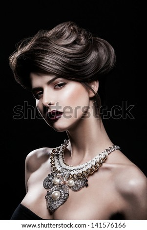 portrait of a beautiful brunette girl with luxury accessories.Beauty with jewellery - stock photo