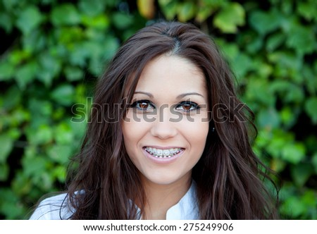 Portrait of a beautiful brunette outdoors in the park - stock photo