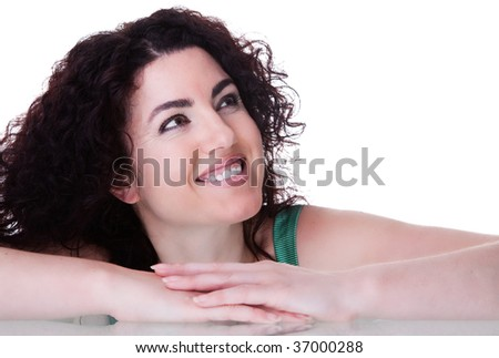 Portrait of a beautiful brunette smiling. Isolated on white. - stock photo