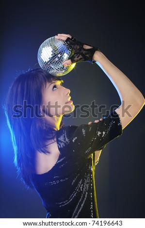Portrait of a beautiful brunette with disco ball