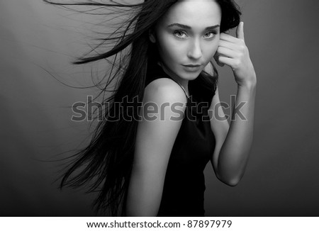 Portrait of a beautiful brunette woman. Black-white Fashion Photo. - stock photo