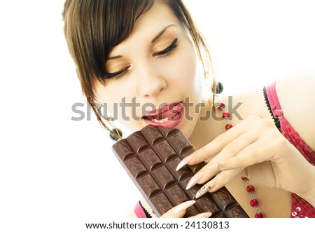 portrait of a beautiful brunette woman eating chocolate, isolated against white background