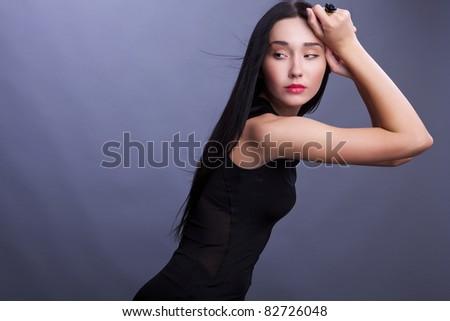 Portrait of a beautiful brunette woman. Fashion Photo. - stock photo