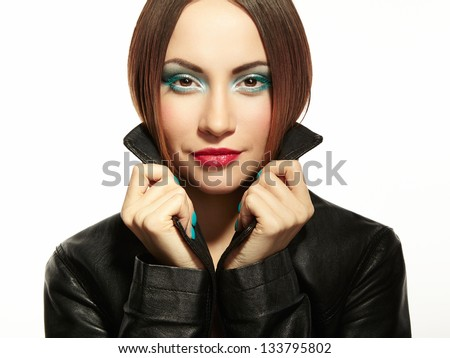 Portrait of a beautiful brunette woman in leather jacket. Fashion Photo. - stock photo