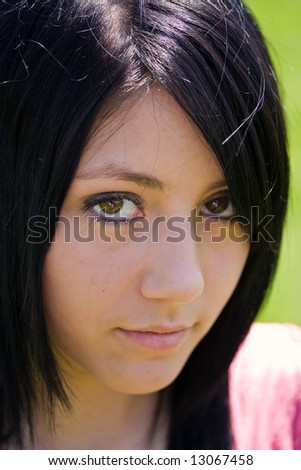 Portrait of a beautiful brunette woman outdoors - stock photo