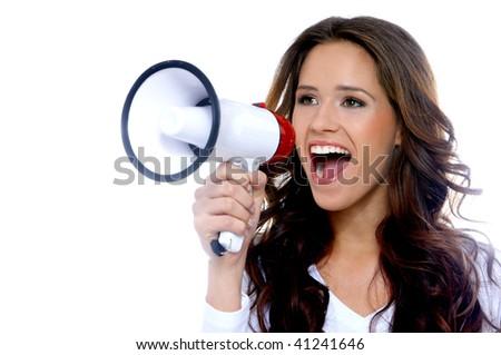 Portrait of a beautiful brunette woman shouting through megaphone - stock photo