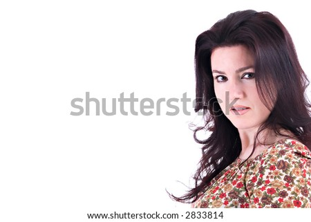 Portrait of a beautiful brunette woman smiling with copy space. - stock photo
