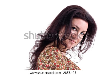 Portrait of a beautiful brunette woman with blue eyes smiling with copy space on white background. - stock photo