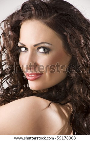 Portrait of a beautiful brunette woman with creativity hairstyle and makeup smiling - stock photo