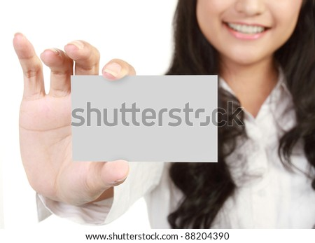 Portrait of a beautiful business woman holding a blank card. isolated on white background - stock photo