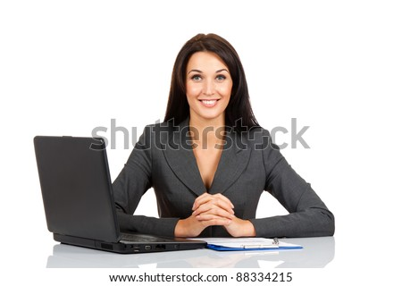 Portrait of a beautiful business woman smile sitting at the desk looking at camera working isolated over white background - stock photo