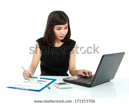 Portrait of a beautiful business woman working on her desk