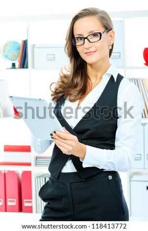 Portrait of a beautiful business woman working with touchpad pc at the office. - stock photo