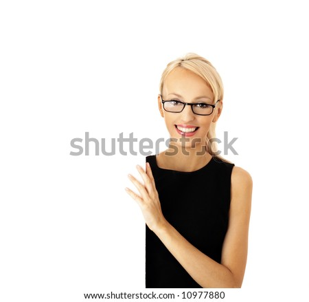Portrait of a beautiful businesswoman holding a blank billboard - stock photo