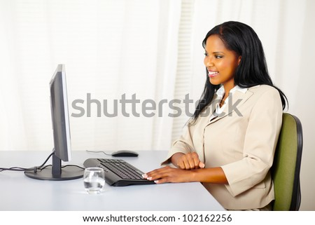 Portrait of a beautiful businesswoman looking the computer screen