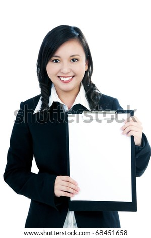 Portrait of a beautiful businesswoman showing clipboard with copy space over white background.