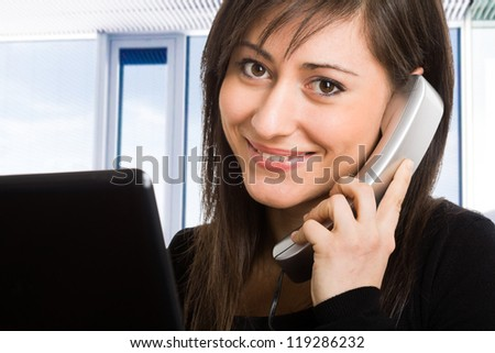 Portrait of a beautiful businesswoman talking on the phone - stock photo