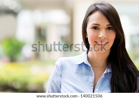 Portrait of a beautiful casual business woman smiling - stock photo