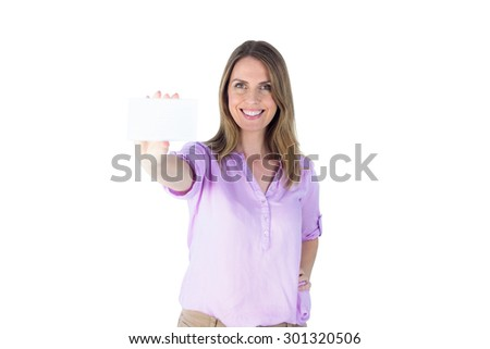 Portrait of a beautiful casual businesswoman showing a sign against a white wall - stock photo