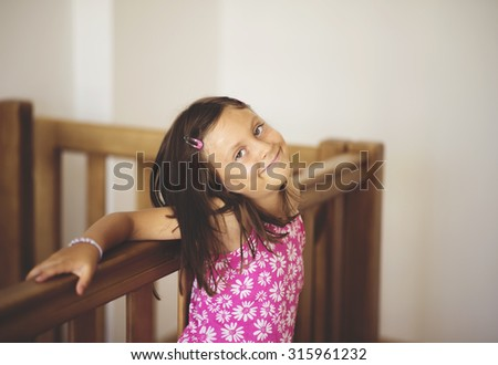 portrait of a beautiful Caucasian girl  posing for camera. cute expression on her face, peaceful and satisfied school girl - stock photo