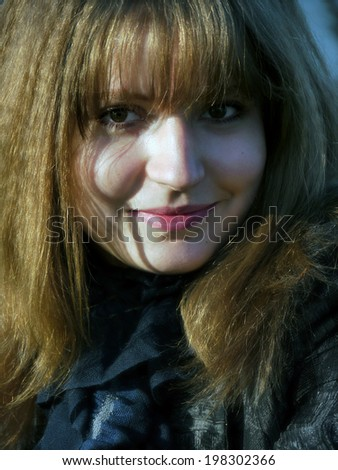 Portrait of a beautiful, charming girl, a close-up. - stock photo
