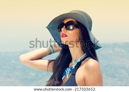 Portrait of a beautiful charming girl posing against the blue sky during summer time  - stock photo