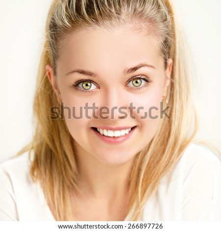 Portrait of a beautiful cheerful girl. - stock photo