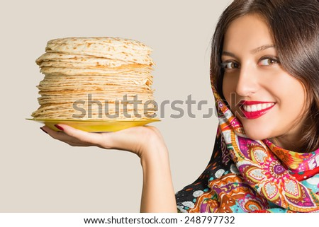 Portrait of a beautiful cheerful young woman with pancakes. - stock photo