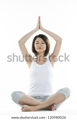 Portrait of a beautiful Chinese woman doing yoga exercise - stock photo