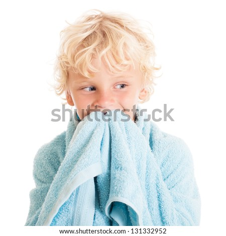 Portrait of a beautiful curly blond European boy wearing swimming shorts. Studio shot, isolated on white background. - stock photo