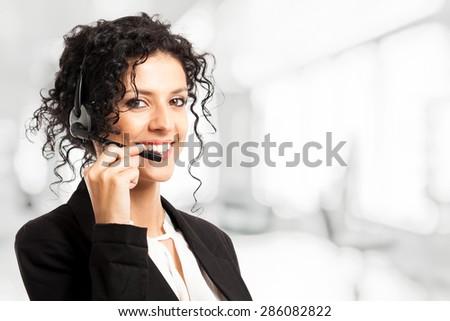 Portrait of a beautiful customer representative woman at work - stock photo