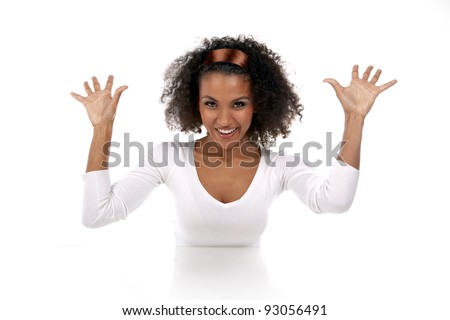 portrait of a beautiful dark-skinned woman with hands up in a white dress in the studio - stock photo