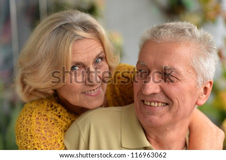 Portrait of a beautiful elderly couple posing in the room